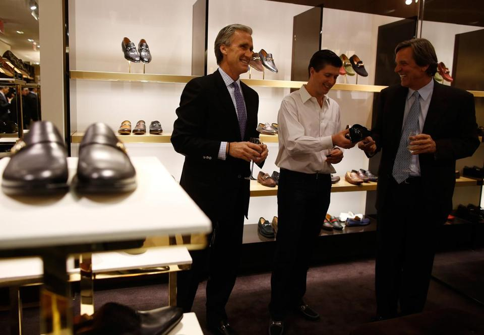 From left: Rob Griffin, of Scituate, his son Corey, of New York, and Eric Limont, of Marshfield, checked out shoes at the Gucci boutique.
